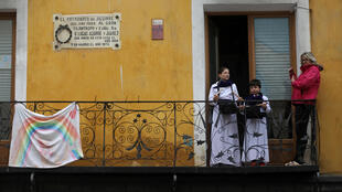 Children play the drums from their balcony after the Way to the Calvary procession, known as the Turbas (mobs), was cancelled due to the coronavirus outbreak in Cuenca, Spain on April 10, 2020.