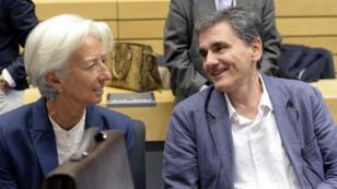 La directrice du FMI, Christine Lagarde, en pleine discussion avec le ministre grec des Finances Euclid Tsakalotos à Bruxelles, le 12 juillet 2015.