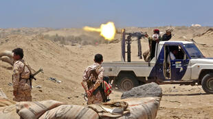 Fighters from of the Southern Transitional Council (STC) fire towards positions of Saudi-backed government forces during clashes in the southern Abyan province