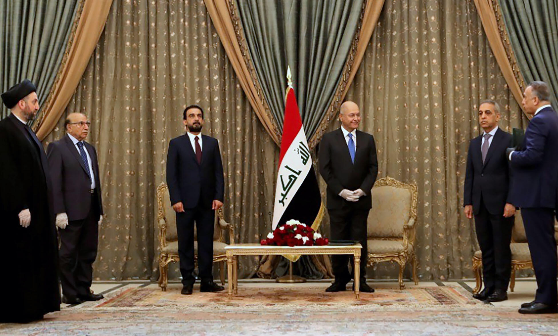 A handout picture released by the media office of the Iraqi presidency on April 9, 2020 showing President Barham Saleh (third from right) with his new prime minister-designate Mustafa Kadhemi (right).