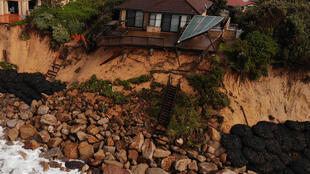 Dozens of seafront homes in Wamberal are at risk of falling into the sea after storms eroded the beach