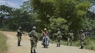 Colombian soldiers patrol in the FARC fiefdom of Caqueta in November 2014.