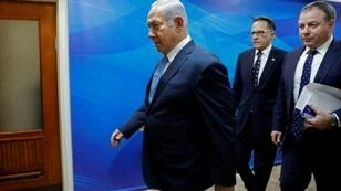 Israel's Prime Minister Benjamin Netanyahu arrives ahead of the weekly cabinet meeting at his office in Jerusalem on September 12, 2018