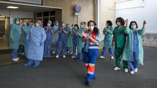 Healthcare workers acknowledged applause as Spaniards thanked them with a clapping tribute Sunday evening