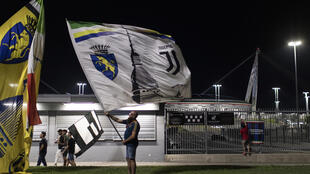 Fans celebrating outside the Allianz Stadium after Juventus won a ninth Serie A title in a row.