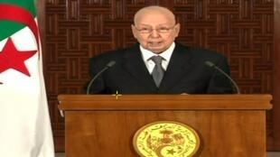 صورة عن الشاشة خلال خطاب الرئيس الجزائري المؤقت عبد القادر بن صالح، الجزائر العاصمة، في 3 يوليو/تموز 2019