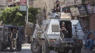 جنود من الشرطة المصرية في مدينة العريش في سيناء 26 يوليو/تموز 2018