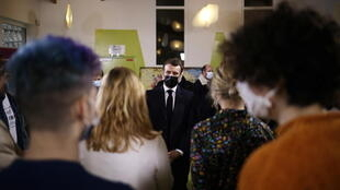 French President Emmanuel Macron talks with students at Paris-Saclay University near the French capital on January 21, 2021.
