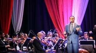 Egyptian classical Arabic music singer Ahmad Adel performs a song by celebrated 20th century Egyptian composer Mohamed Abdel Wahab, at the Arab Music Institute Theatre