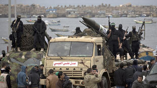 Hamas militants display rockets in Gaza during the movement's 27th anniversary parade on December 14.