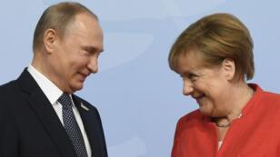 Angela Merkel et Vladimir Poutine, au sommet du G20 à Hambourg, le 7 juillet 2017.