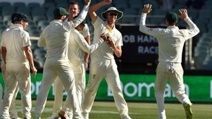 Australia's Pat Cummins (C) grabbed international attention with his spectacular run out.