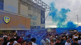 Leeds United supporters gather outside their Elland Road ground to celebrate promotion