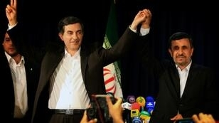 Esfandiar Rahim Mashaie (L) is seen at a news conference in Tehran on May 11, 2013 with Iran's then president Mahmoud Ahmadinejad