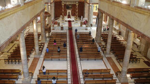 Christian worshippers maintain social distancing as they attend Sunday mass at the re-opened Saint George Maronite Church in the Lebanese capital Beirut on May 10, 2020