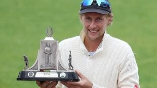 England captain Joe Root holds the Wisden Trophy following his side's 2-1 Test series victory over the West Indies