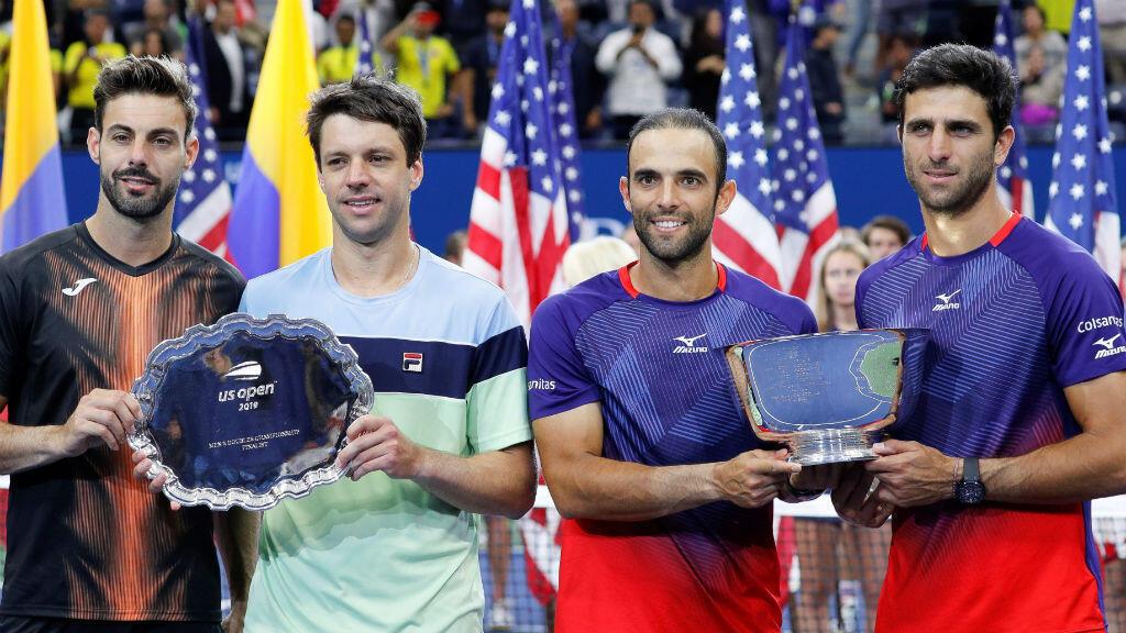 El español Marcel Granollers y el argentino Horacio Zeballos (izquierda) y los colombianos Juan Sebastián Cabal y Robert Farah, finalistas del US Open, en Nueva York, Estados Unidos, el 6 de septiembre de 2019.