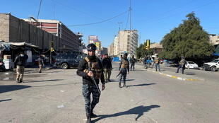Iraqi security forces secure the site of a suicide attack in Baghdad, Iraq January 21, 2021.
