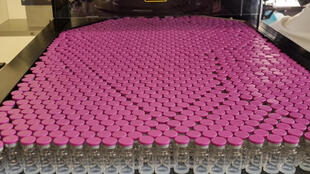 Handout photo released by French pharmaceutical subcontracting firm Delpharm on April 7, 2021, shows a vials being filled with the Pfizer/BioNTech vaccine.