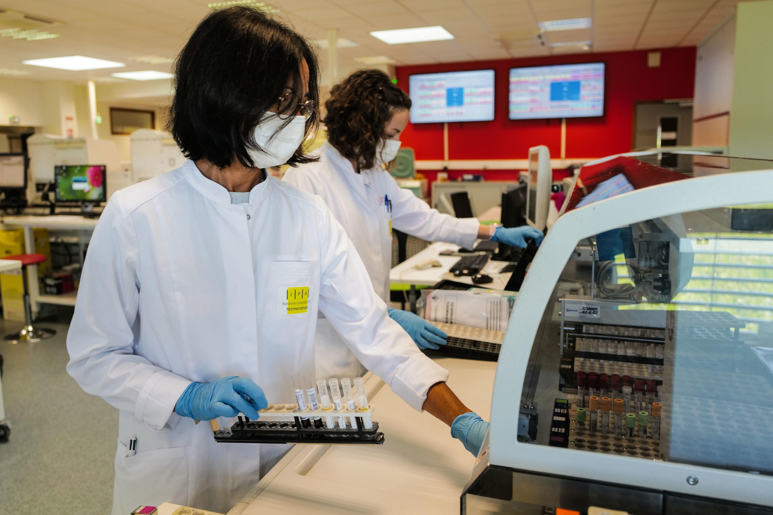 Technicians handling blood samples for Covid-19 tests at the LPA analysis laboratory in Besançon, France on May 29 2020.