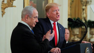 US President Donald Trump and Israeli Prime Minister Benjamin Netanyahu hold a joint press conference to discuss the proposed new Middle East peace plan at the White House in Washington, USA, on January 28 2020.