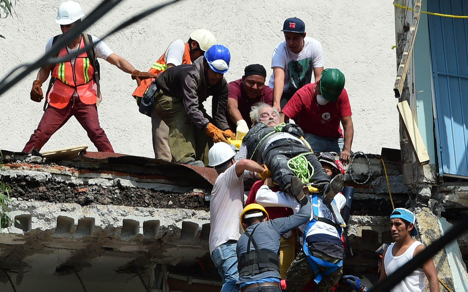 A man is rescued from the rubble of a collapsed building in Mexico City.
