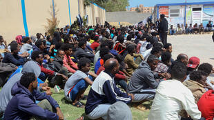 Tens of thousands of refugees and asylum-seekers -- similar to these African migrants who fled Libyan battle zones, pictured April 2019 at at a detention center in Zawiya -- have been stranded in chaos-wracked Libya