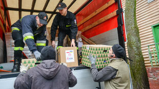 Polish aid supplies arrive at a camp for displaced people near Kharkiv in eastern Ukraine on Friday.