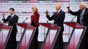 South Bend Mayor Pete Buttigieg, Senator Elizabeth Warren, former Vice President Joe Biden and Senator Bernie Sanders all simultaneously seek the opportunity to speak during the sixth 2020 U.S. Democratic presidential candidates campaign debate at Loyola Marymount University in Los Angeles, California, U.S., December 19, 2019.