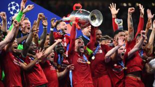 Liverpool captain Jordan Henderson lifts the Champions League trophy