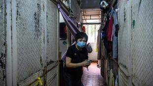 Wong Mei-ying knows social-distancing is almost impossible in the Hong Kong flat she shares with 12 other people