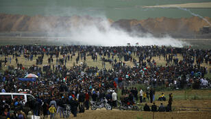 Mohammed Abed, AFP | Palestinians protest near the border with Israel in the northern Gaza strip on March 30, 2018.