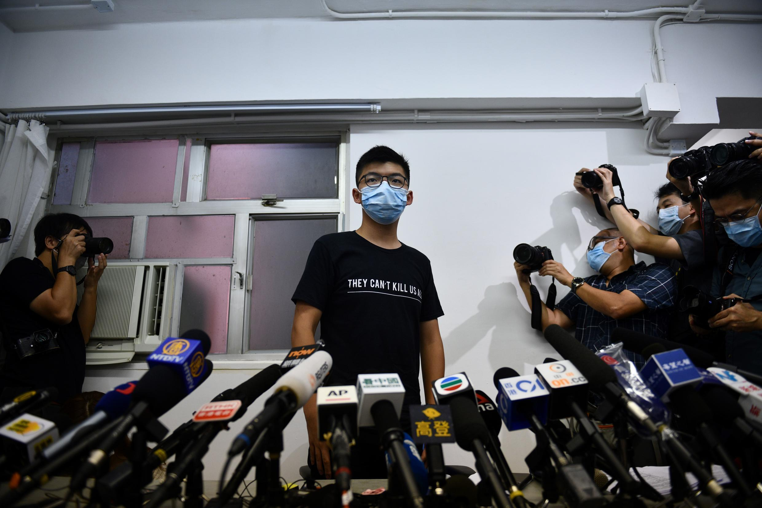 Hong Kong pro-democracy dissident Joshua Wong slammed authorities for disqualifying activists for candidature in September's legislative elections.