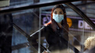 A woman wearing a mask looks on at a terminal at Ben Gurion International airport in Lod, near Tel Aviv, Israel February 27, 2020.
