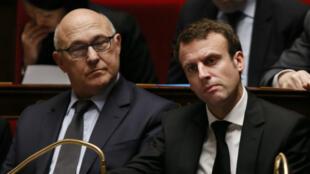 Emmanuel Macron et Michel Sapin à l'Assemblée nationale, mardi 17 février 2015.