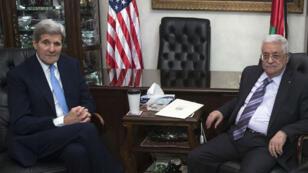 US Secretary of State John Kerry and Palestinian leader Mahmoud Abbas meet in Jordan on October 24, 2015.