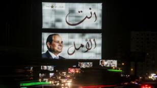 Des affiches de campagne d'Abdel Fattah al-Sissi s'affichent partout dans les rues du Caire.
