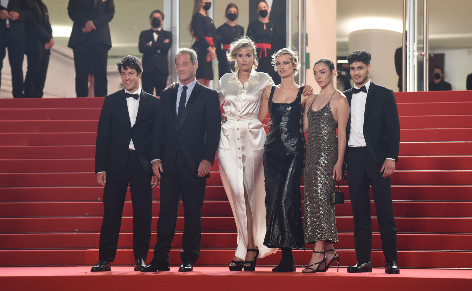 Director Julia Ducournau and her team pose on the the steps of the Palais des Festivals before the screening of 'Titane'.