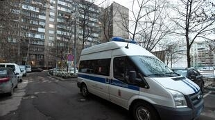 A police vehicle is seen parked outside a building housing a flat used by Kremlin critic Alexei Navalny in Moscow on January 27, 2021.