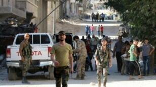 انتشار لقوات موالية للنظام السوري في حي بني زيد