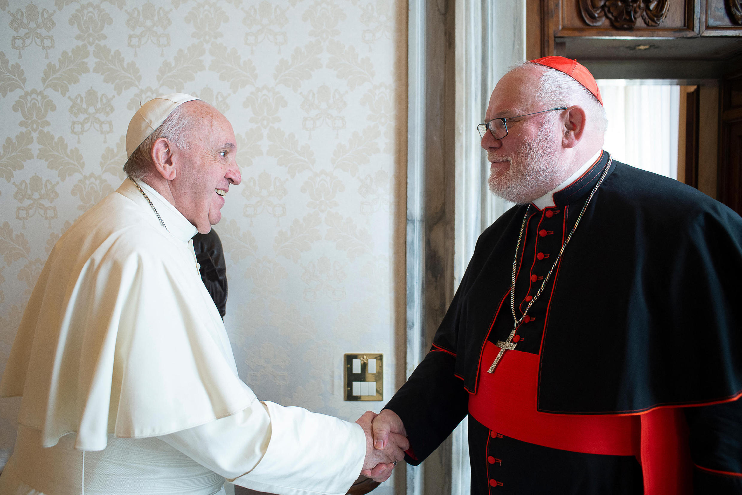 Pope Francis greeting the president of the German Bishops' Conference, the Archbishop of Munich and Freising, the German Cardinal Reinhard Marx during a private audience at the Vatican.  Photo taken and distributed on February 3, 2020 by the Vatican media