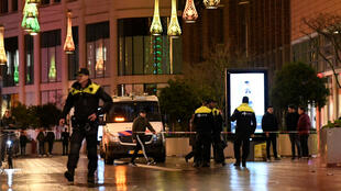 Police patrol near the site of a stabbing in a shopping district in The Hague, the Netherlands, November 29, 2019.