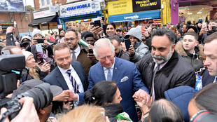 In this photo taken on February 4, 2020, Britain's Prince Charles leaves after visiting the TK Maxx Tooting store in London, Britain.