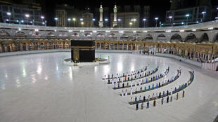 A picture taken June 23, 2020 shows a few worshippers praying at the Grand Mosque in Saudi Arabia's holy city of Mecca