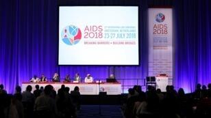 Funcionarios participan en la 22ª Conferencia Internacional sobre el sida (AIDS 2018), la mayor reunión centrada en el VIH / SIDA en el mundo, en Amsterdam, Países Bajos, el 23 de julio de 2018.