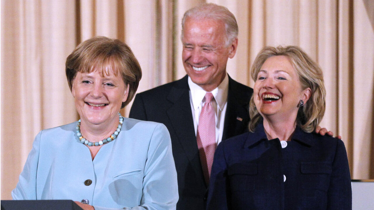 German Chancellor Angela Merkel, US VP Joe Biden and Secretary of State Hillary Rodham Clinton, laugh during a State Luncheon in Merkel's honour at the State Department in Washington on June 7, 2011.