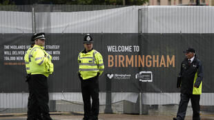 Police officers and security stand outside the perimetre around the International Convention Centre venue in Birmingham, central England, on October 1, 2016