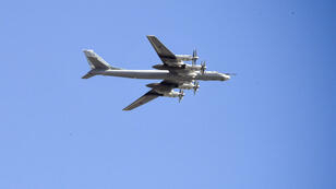 Alexander Nemenov, AFP | A Tu-95MS Russian armed forces bomber flying over Moscow on May 7, 2019.