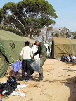 Soldiers and NGOs join in cleaning up the debris of thousands of refugees. ©Marie Valla