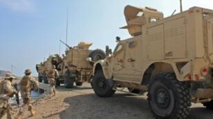 Saudi-led coalition forces patrol the southern Yemeni port of Aden on October 29, 2018